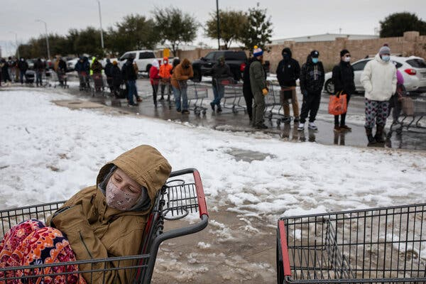 A line of people waited to enter a grocery store in Austin, Texas, on Tuesday.