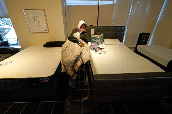 Dialina Gonzalez gathered her belongings after spending the night on a mattress inside Gallery Furniture.