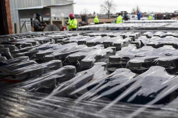 Pallets of bottled water were lined up for delivery to vulnerable populations in Houston.