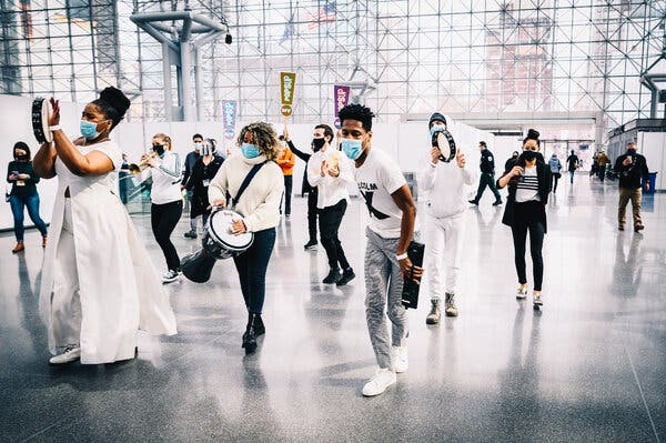 """A performance by Jon Batiste, center, and his band Stay Human in New York on Saturday was the first in a series of """"pop-up"""" shows meant to give the arts a jolt."""