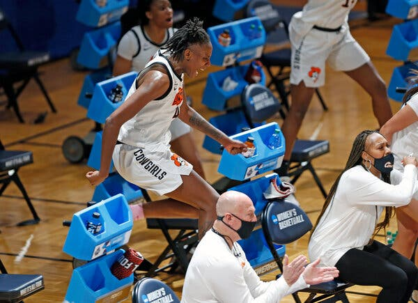 Natasha Mack leapt over chairs to cheer on her teammates during the first round.