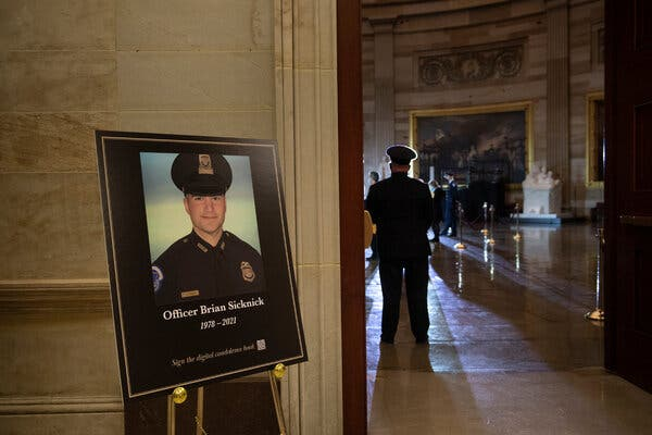 A placard honors Officer Brian Sicknick of the Capitol Police in the Rotunda in early February.