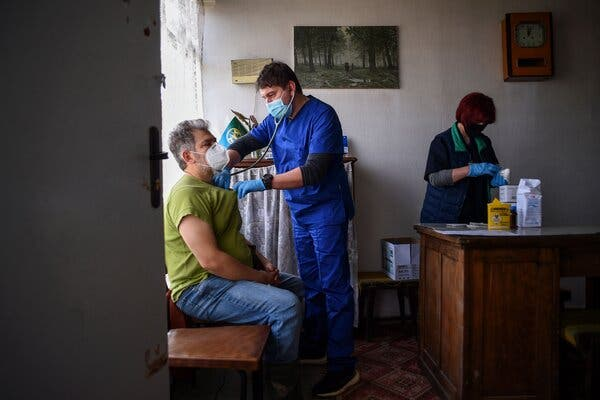 A healthcare worker checking a man's blood pressure in a mountain village in Bulgaria last month before giving him a dose of AstraZeneca's Covid-19 vaccine. Bulgaria has joined four other countries in halting use of the vaccine while regulators examine reports of blood clots in some recipients.