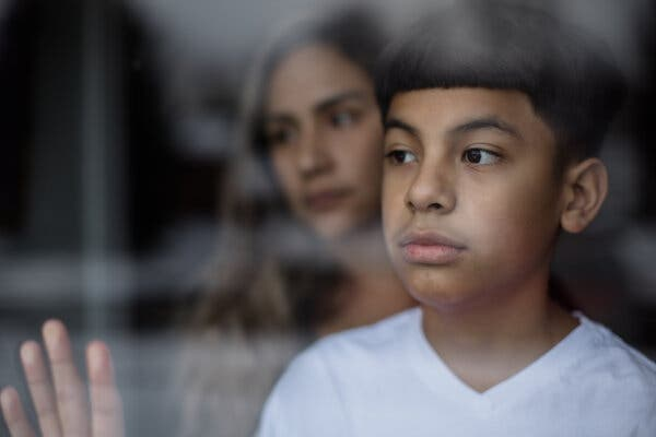 Mayson Barillas, 11, who recently recovered from multisystem inflammatory syndrome with his mother, Sandy Barillas.