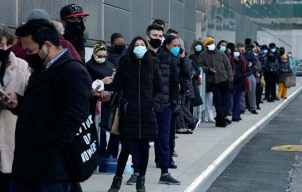 People line up early at the Jacob Javits Convention Center Covid-19 vaccination hub on March 4, 2021.