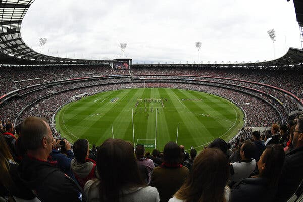 The crowd stood for the Last Post during the round six A.F.L. match between the Collingwood Magpies and the Essendon Bombers at Melbourne Cricket Ground on Sunday.