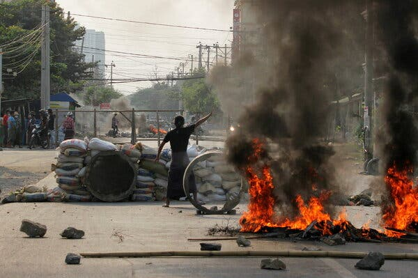A demonstrator against the Myanmar military coup protested near a barricade in Mandalay last month.