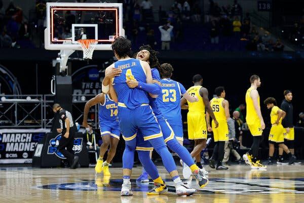 Tyger Campbell embracing Jaime Jaquez Jr. after U.C.L.A. upset Michigan to reach the Final Four.