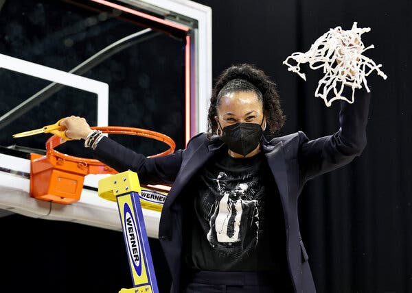 Coach Dawn Staley of South Carolina cuts down the net after reaching the Final Four.