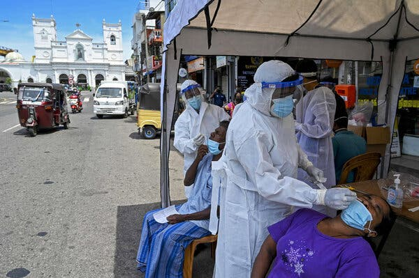 Health care workers administered coronavirus tests in Colombo, Sri Lanka, on Tuesday.