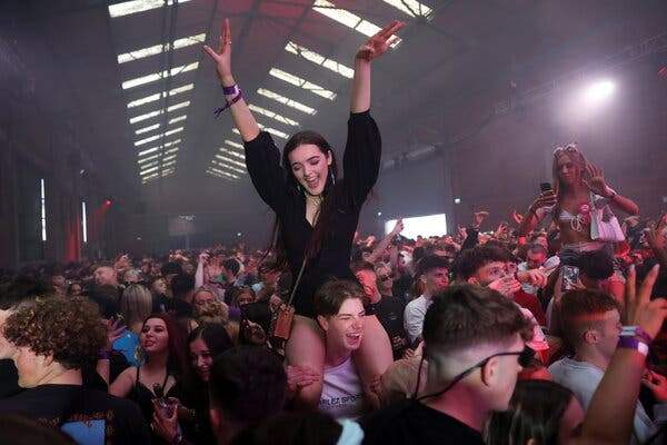 Unmasked clubbers in Liverpool, England, returned to the dance floor as part of an experiment.