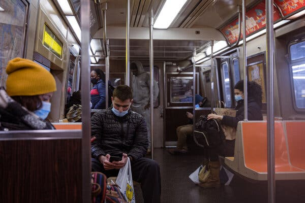People riding the subway in February.