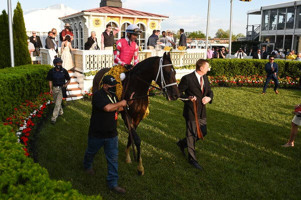 Flavien Prat aboard Rombauer in the winner's circle at the Preakness Stakes on Saturday.