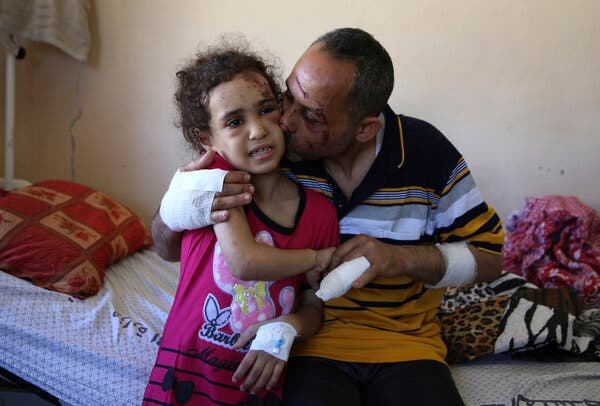 Riad Ishkontana, 42, kissed his daughter, Suzy, 7, at Shifa Hospital in Gaza City on Tuesday. They were pulled from the rubble of their home after an Israeli airstrike killed his wife and their four other children.