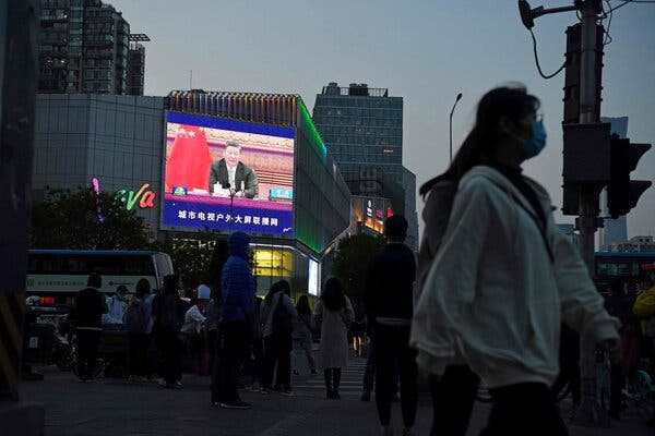 """President Xi Jinping on a screen in Beijing last month. The Chinese government's aggressive brand of """"wolf warrior"""" diplomacy has drawn criticism from other countries."""