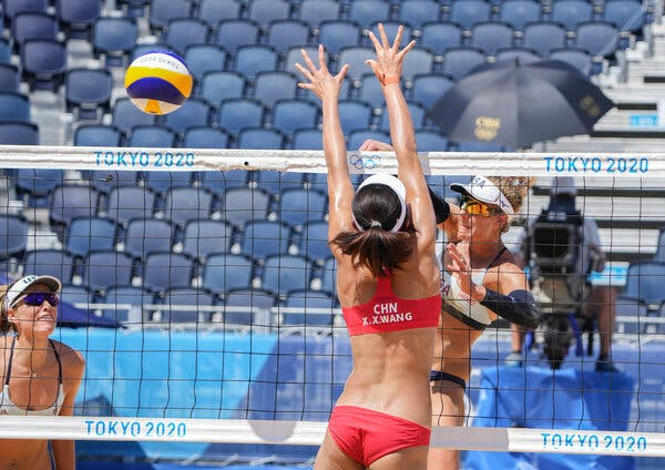 April Ross of the United States powered the ball past Wang Xinxin of China.