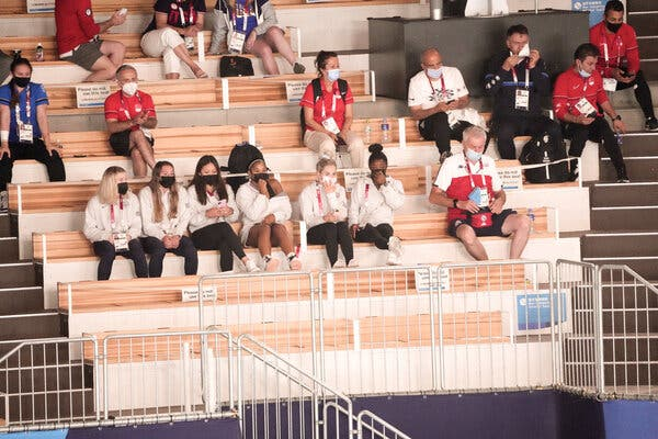 Simone Biles and her teammates watched the U.S. men's gymnasts compete on Saturday.