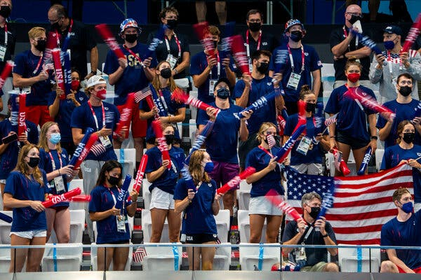 Members of the U.S. swim team cheered for their teammates as they competed in heats on Saturday.