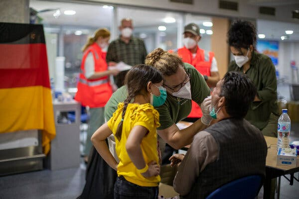 Evacuees from Kabul being tested for the coronavirus upon their arrival at Tashkent Airport in Uzbekistan on Tuesday.