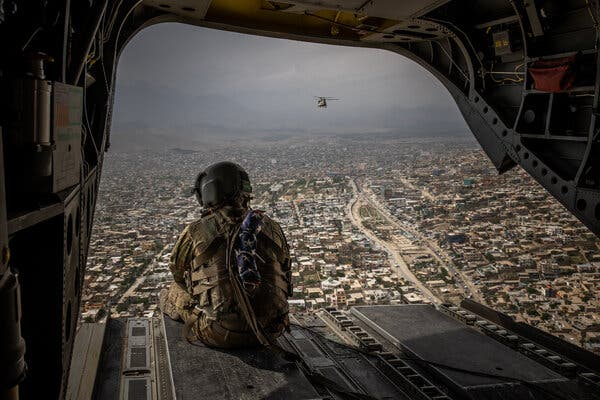 A U.S. Army crew chief aboard a military helicopter over Kabul in May.